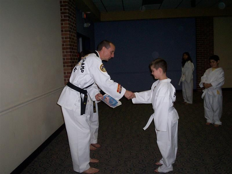 A man teaching young people martial arts.